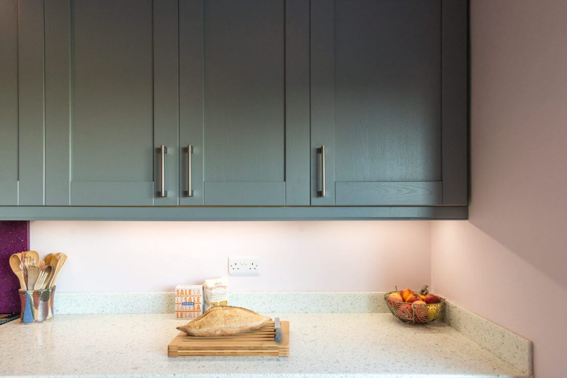 pale blue painted shaker kitchen cupboards and worktop