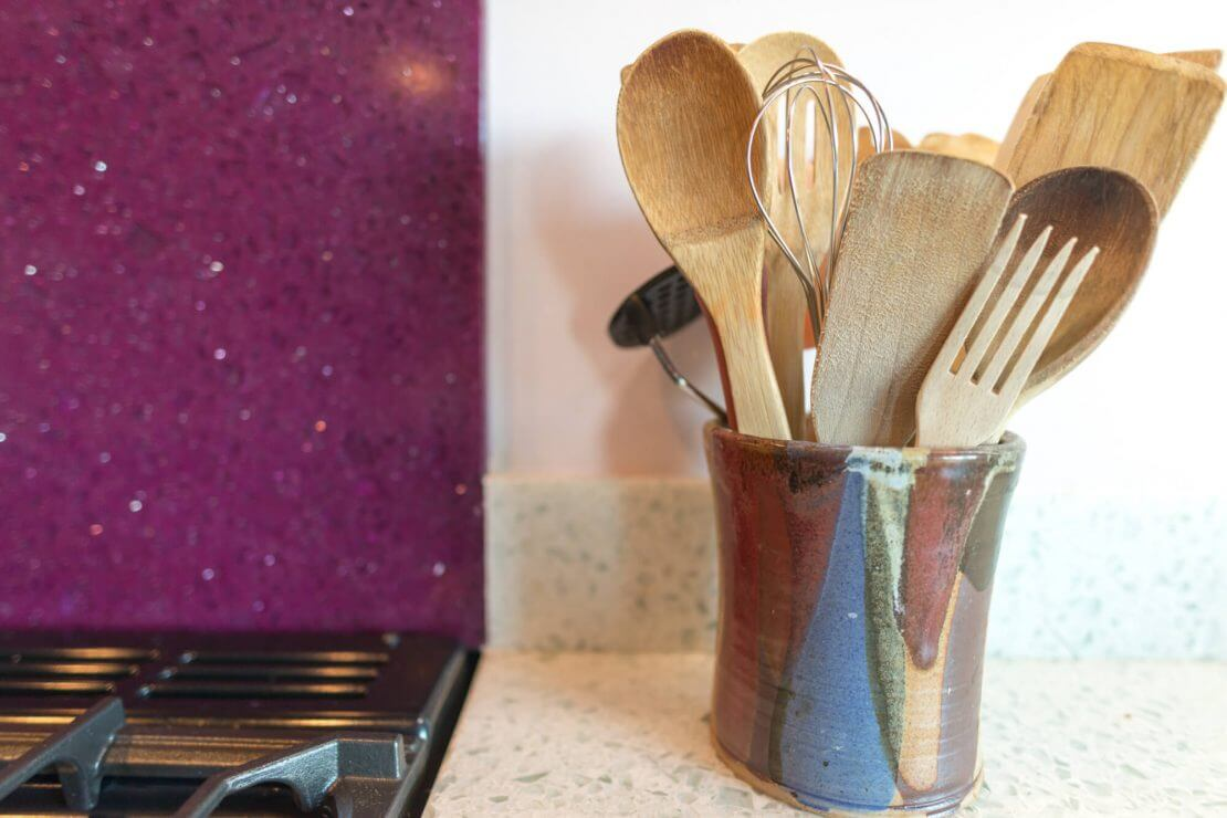 kitchen utensil pot on recycled glass worktop