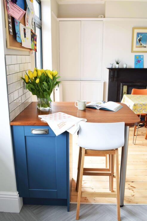 new kitchen with blue shaker doors and reclaimed timber breakfast bar