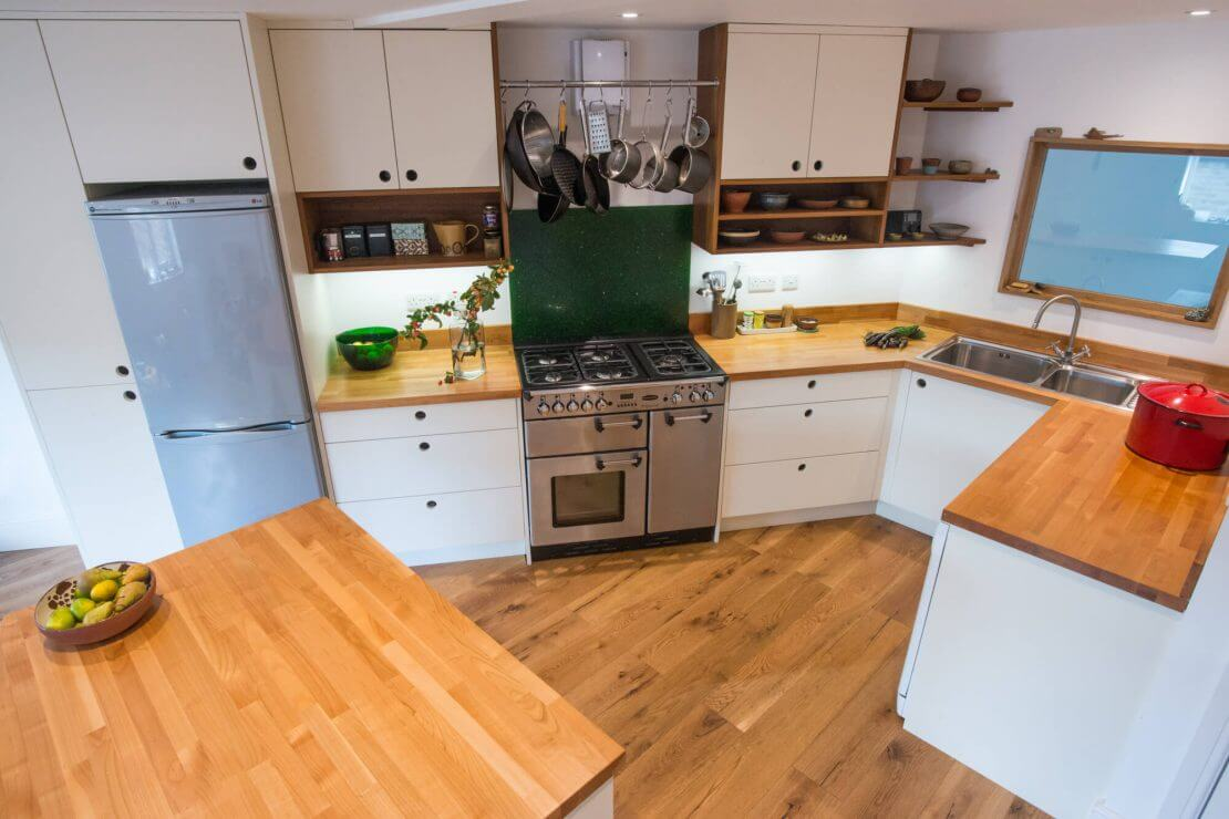 new kitchen with timber worktops and handleless white cabinet doors