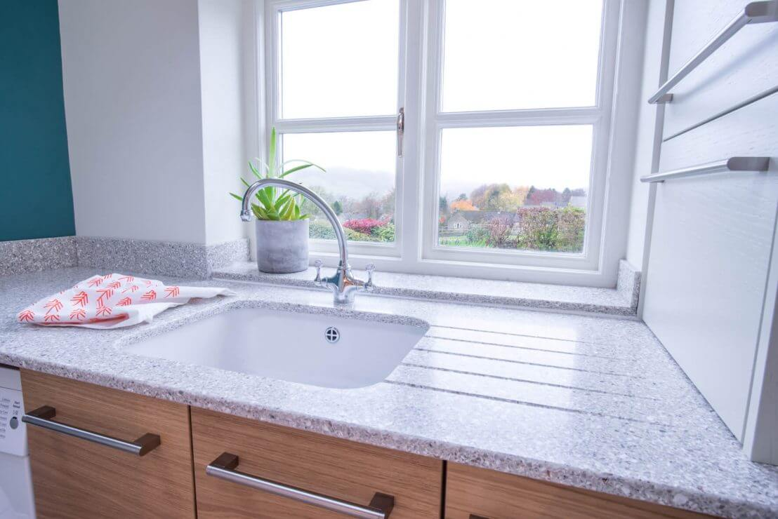 ceramic sink with recycled glass worktop
