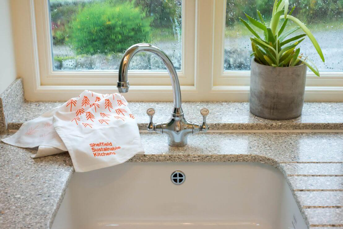ceramic sink and recycled glass worktop in new kitchen