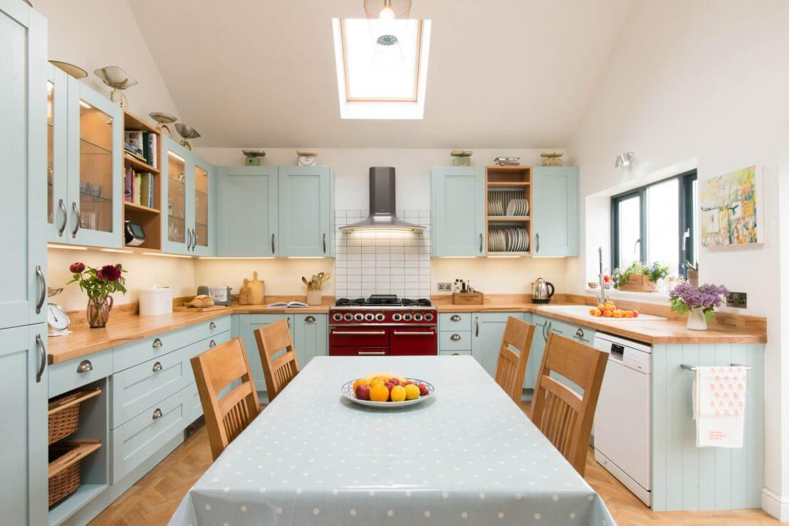 u-shaped new kitchen with blue shaker doors