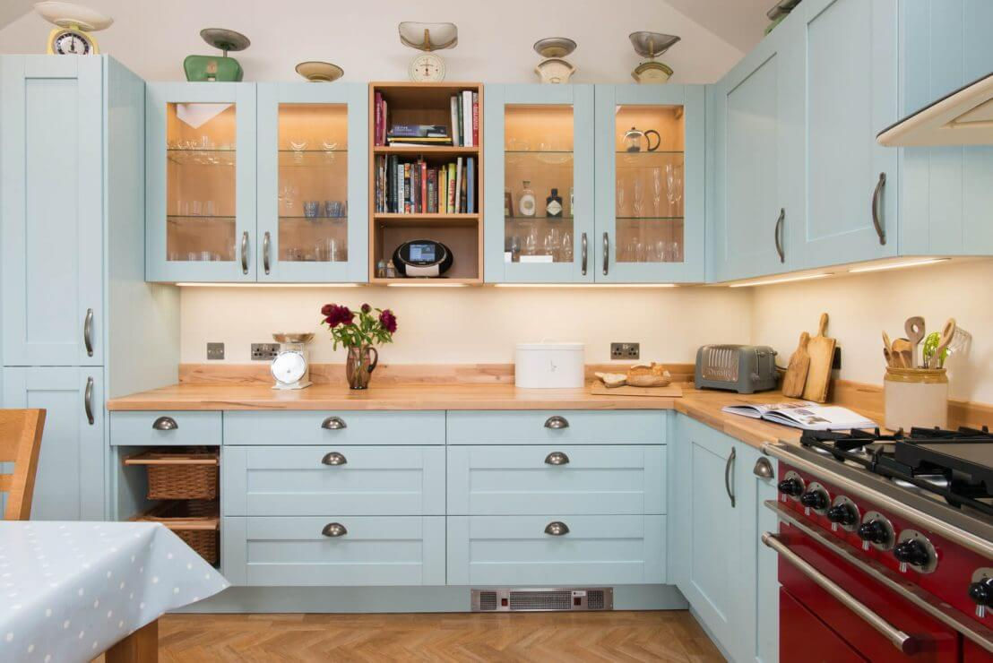 new u-shaped kitchen with pale blue shaker doors