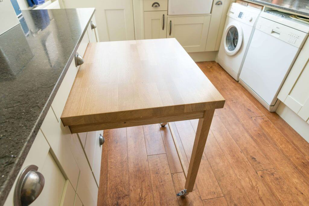 custom shaker kitchen with bespoke kitchen elements and the pullout table