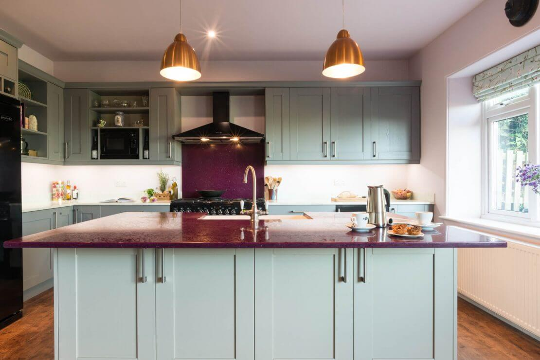 pale blue painted shaker kitchen with recycled glass worktop