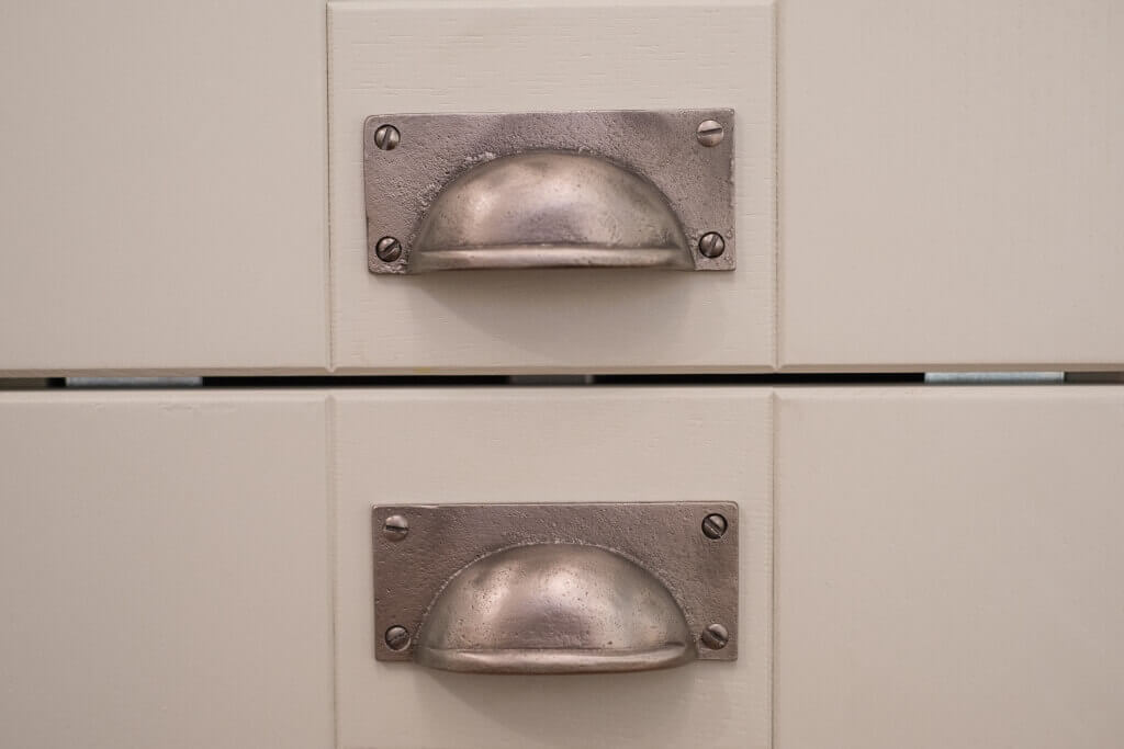 pewter cup handles in shaker kitchen