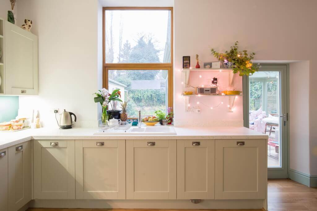 painted shaker L-shaped kitchen