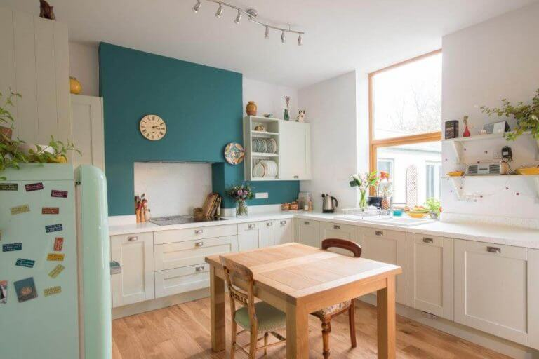 pale green new L-shaped shaker kitchen