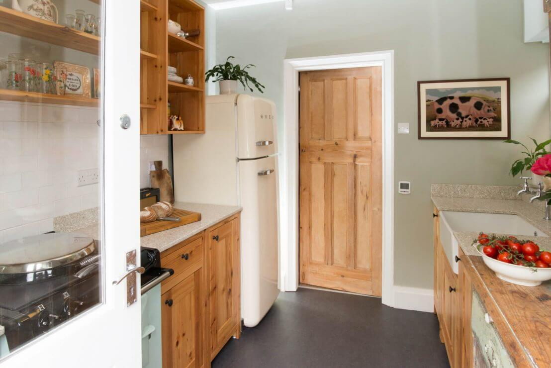 pine galley compact new kitchen with smeg fridge