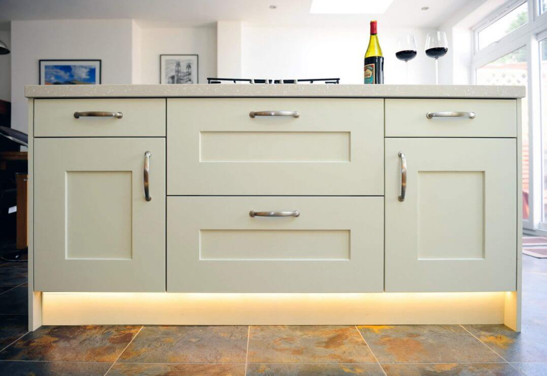 new cream painted shaker kitchen with feature breakfast bar