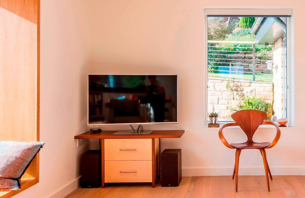 TV on bespoke table made from reclaimed timber