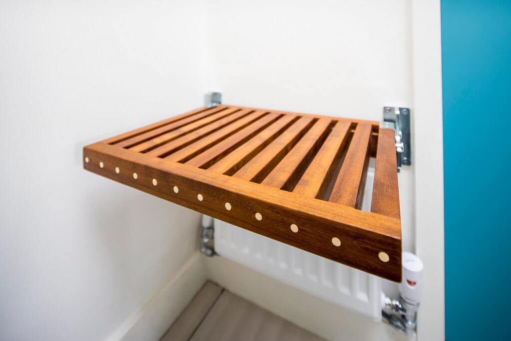 flip down fold-away seat made from reclaimed timber