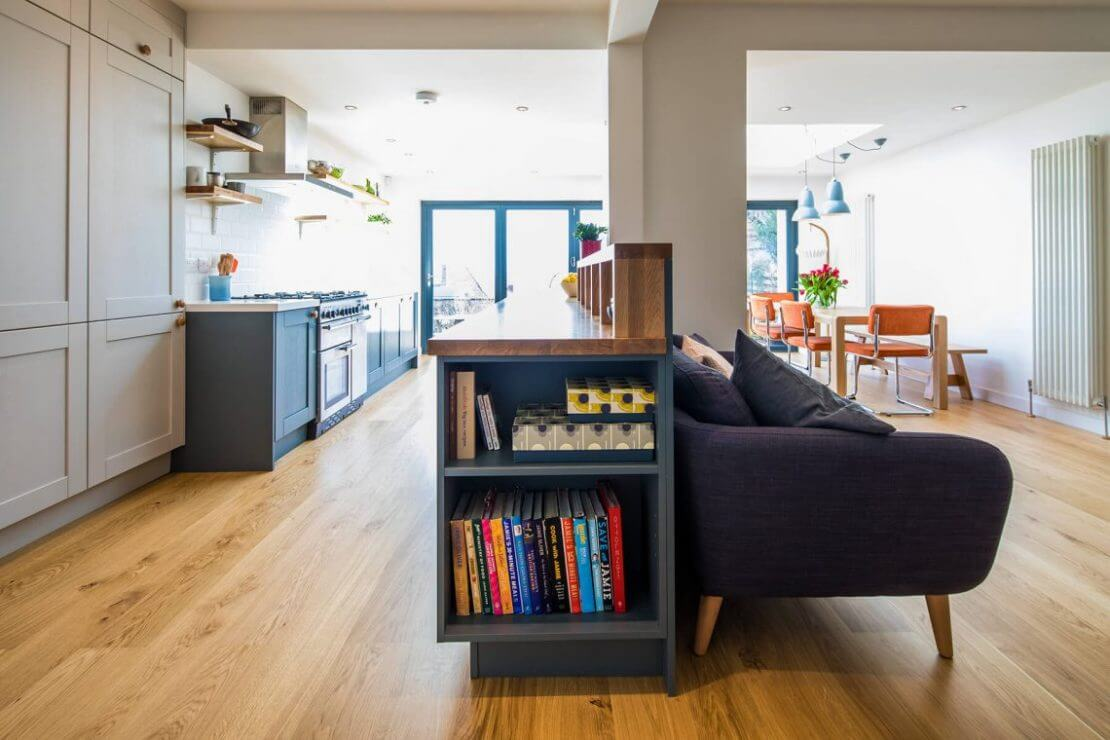 oak galley kitchen with long kitchen island and breakfast bar