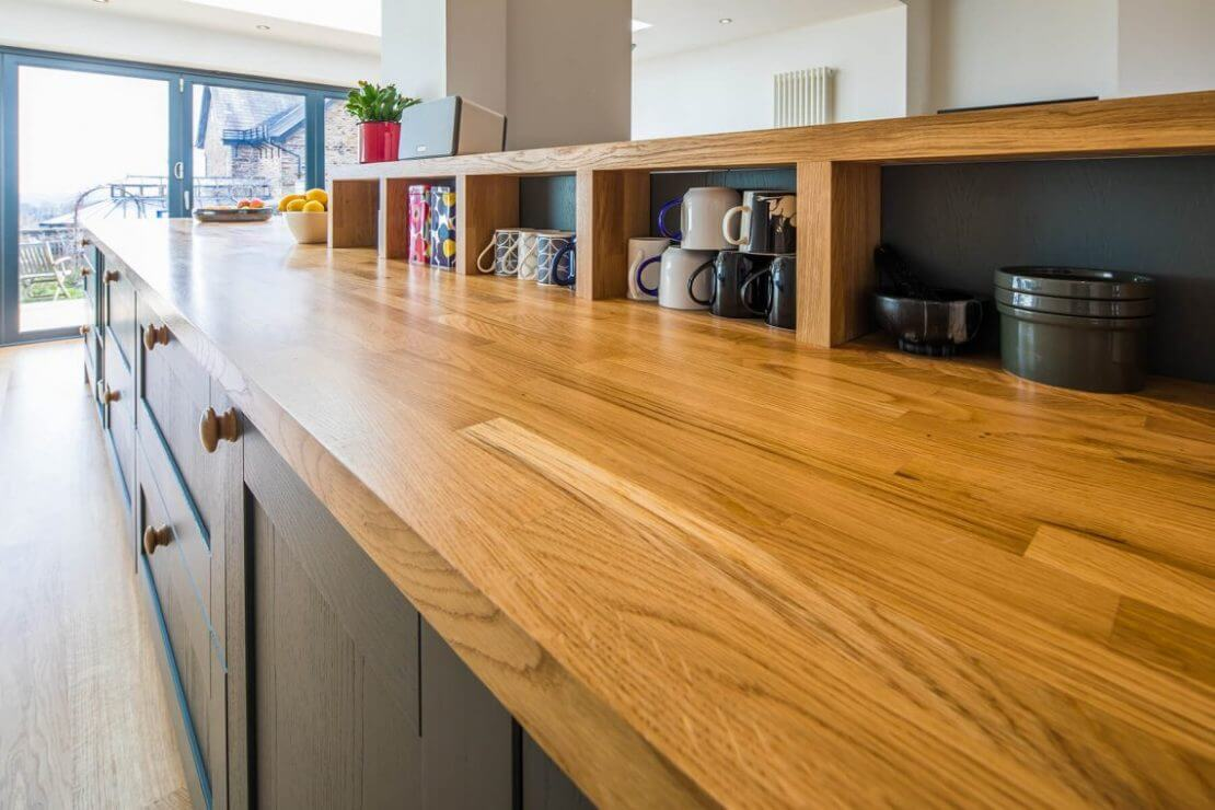 Sheffield Sustainable Kitchens contemporary oak galley kitchen with oak open shelves and farrow and ball painted kitchen cabinet doors