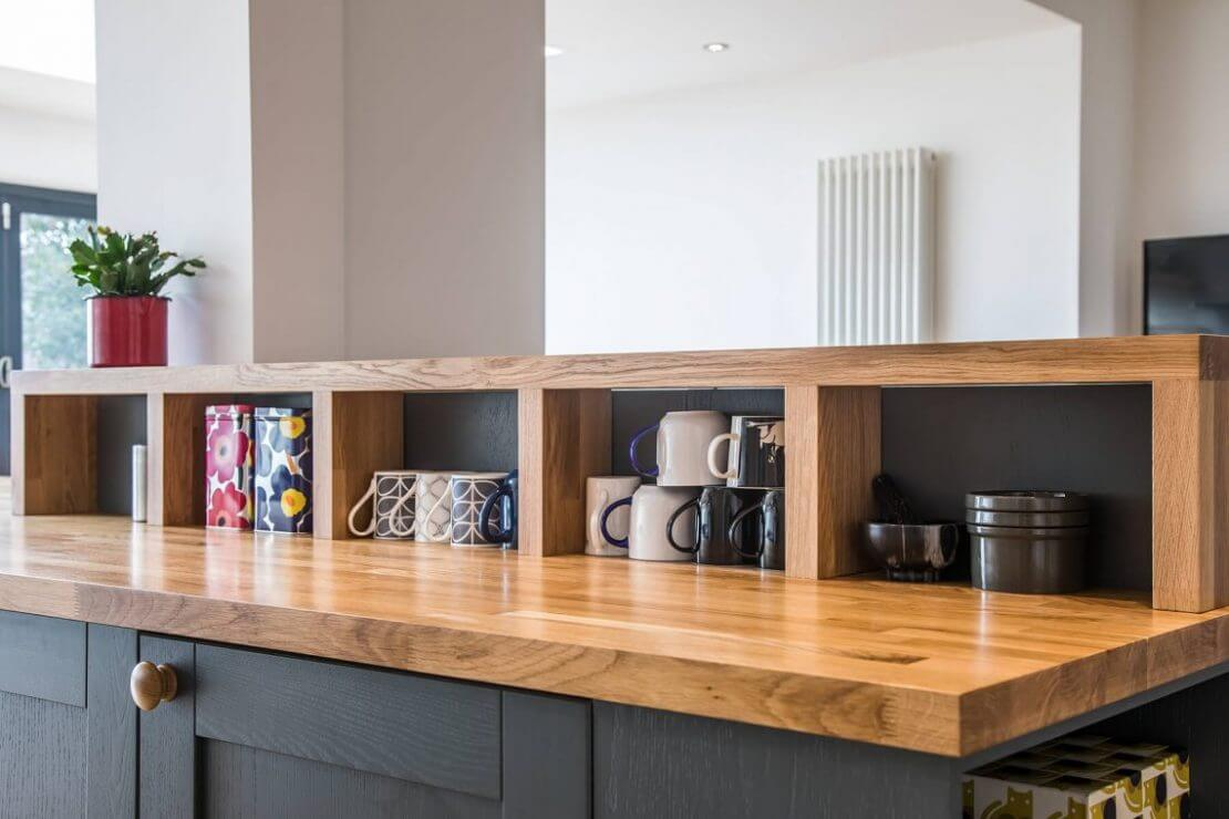 Sheffield Sustainable Kitchens contemporary oak galley kitchen with oak open shelves and worktop
