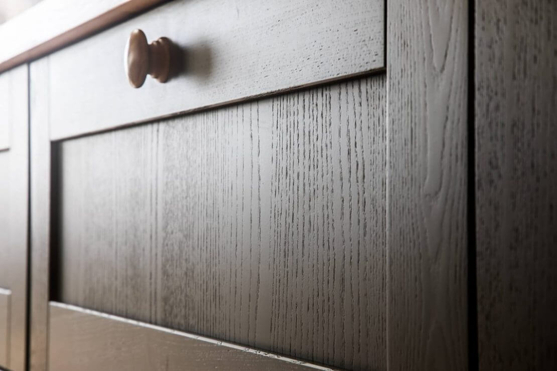 close up of painted shaker door in galley kitchen