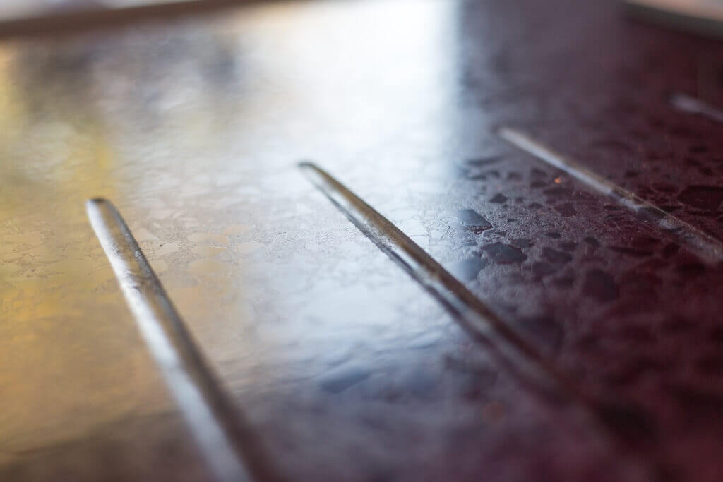 recycled glass worktop with drainer grooves