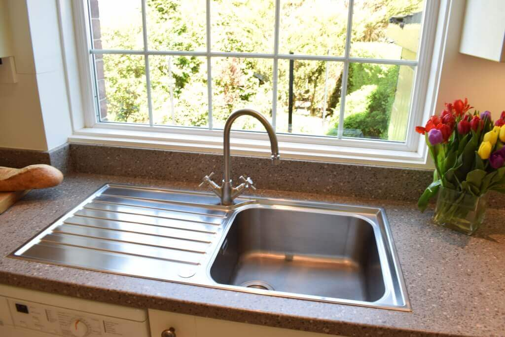 new kitchen with stainless steel sink and tap
