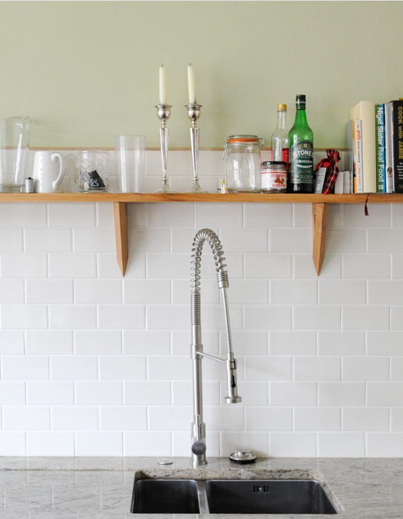 stainless steel kitchen sink and white metro tiles