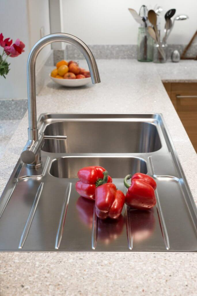 stainless steel kitchen sink with recycled glass worktop