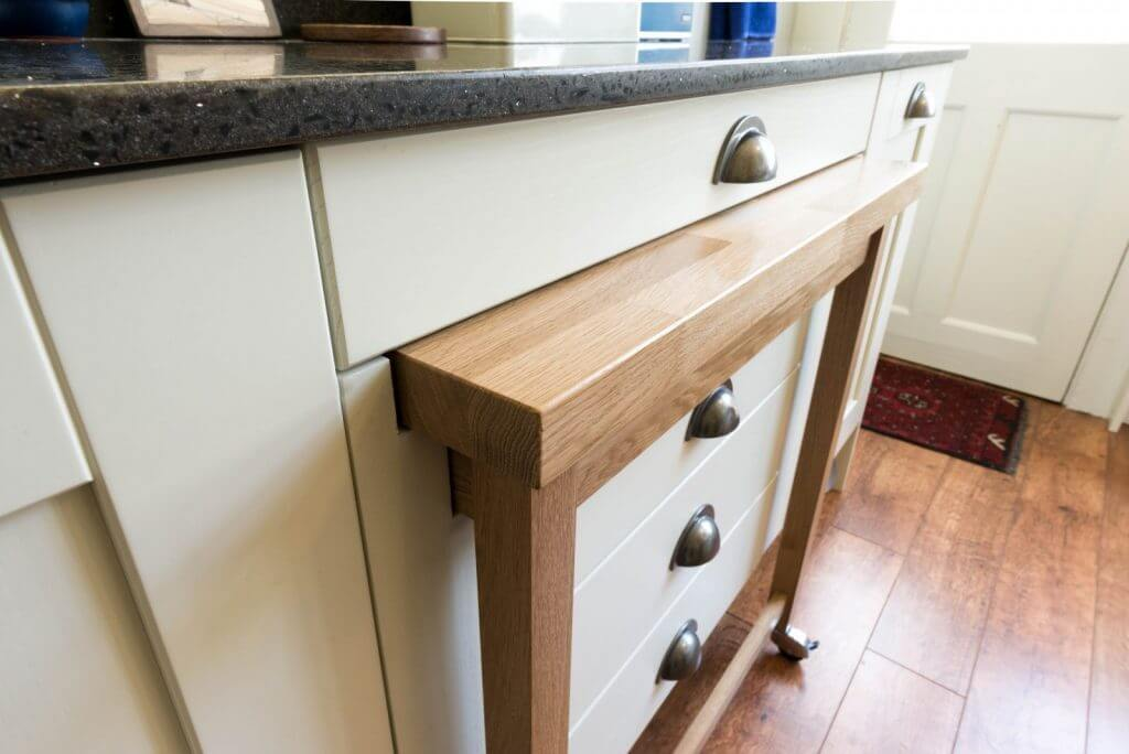 oak pullout table retracted into kitchen drawer unit