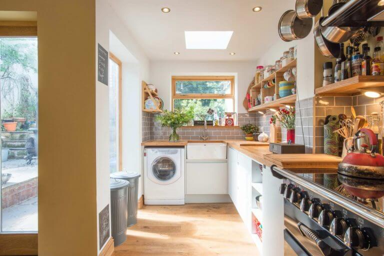 kitchen with pale handleless slab doors with bamboo worktop
