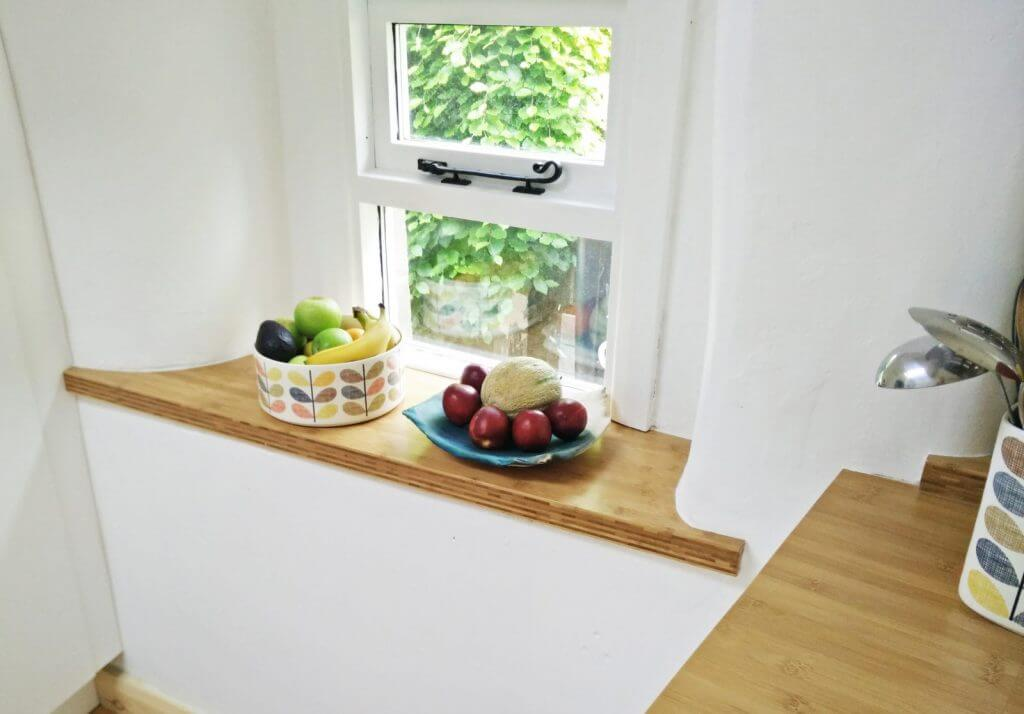 bamboo window sill scribed to fit stone alcove