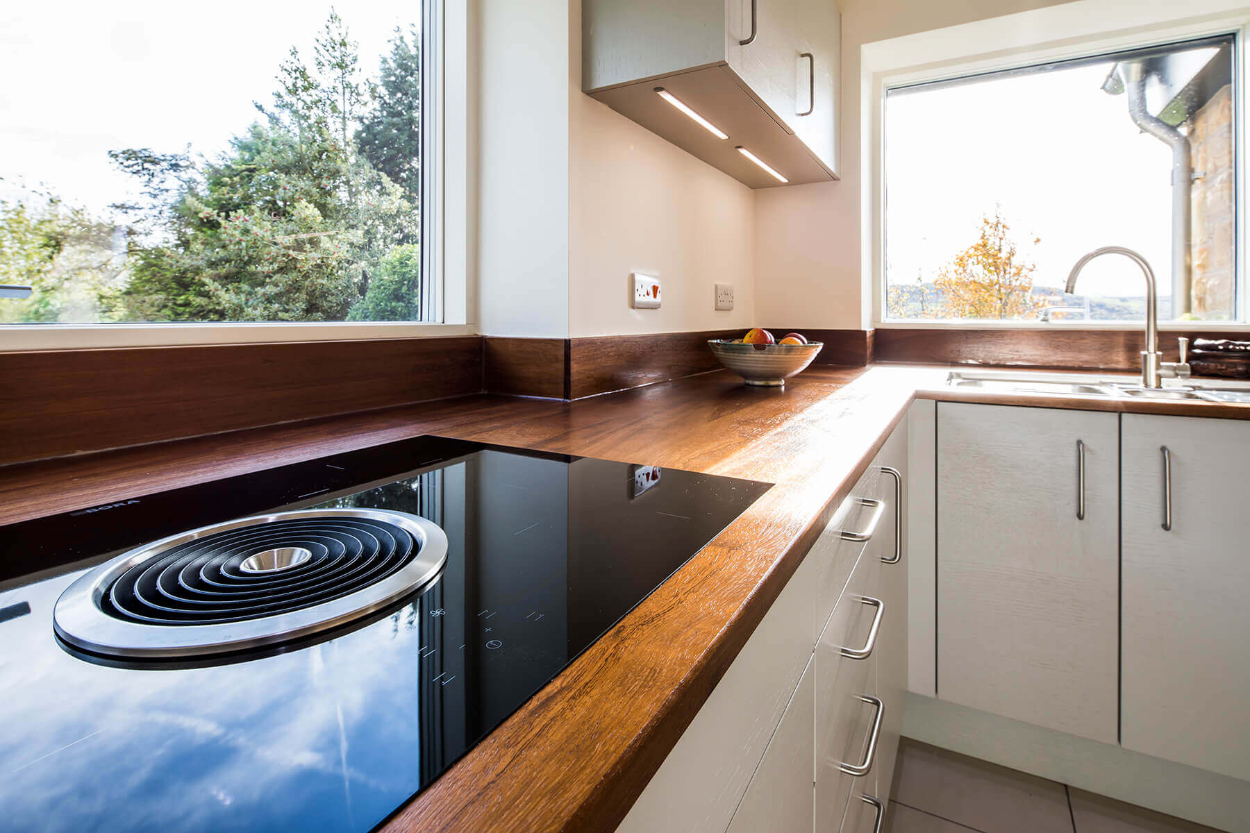 Sheffield Sustainable Kitchens - mid century modern kitchen with reclaimed timber worktop and Bora induction hob with integrated downdraught extractor