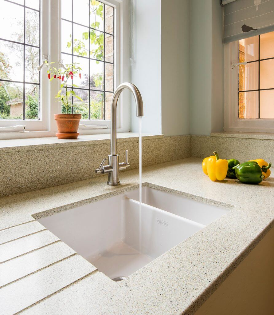 ceramic kitchen sink with recycled glass worktop