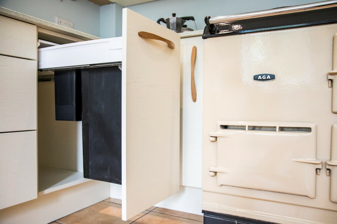 pull out bin next to aga oven in kitchen