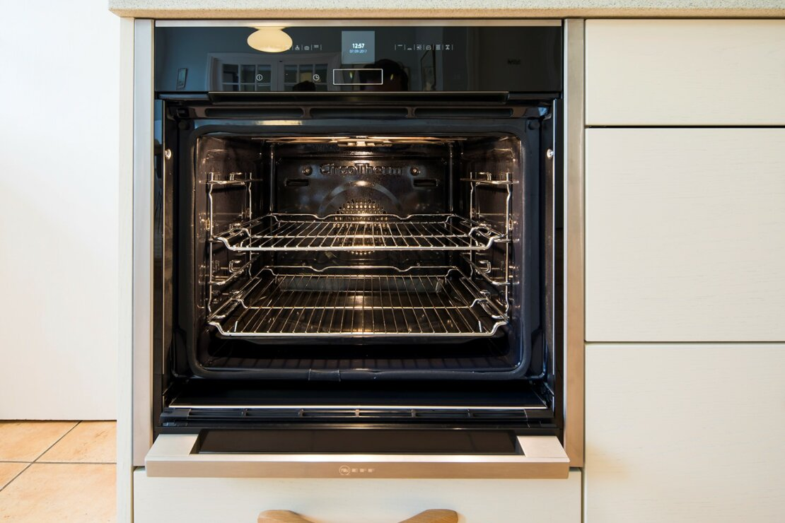 neff slide and hide oven in cream kitchen