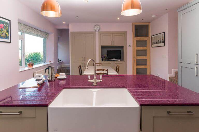 feature kitchen island with bespoke recycled glass worktop