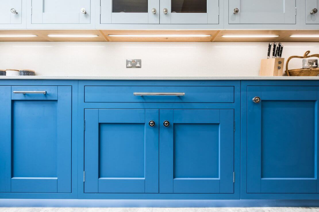 light and dark blue kitchen cabinets with in-frame doors