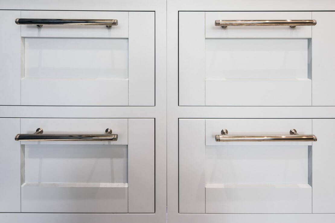 four pale blue kitchen drawers in-frame