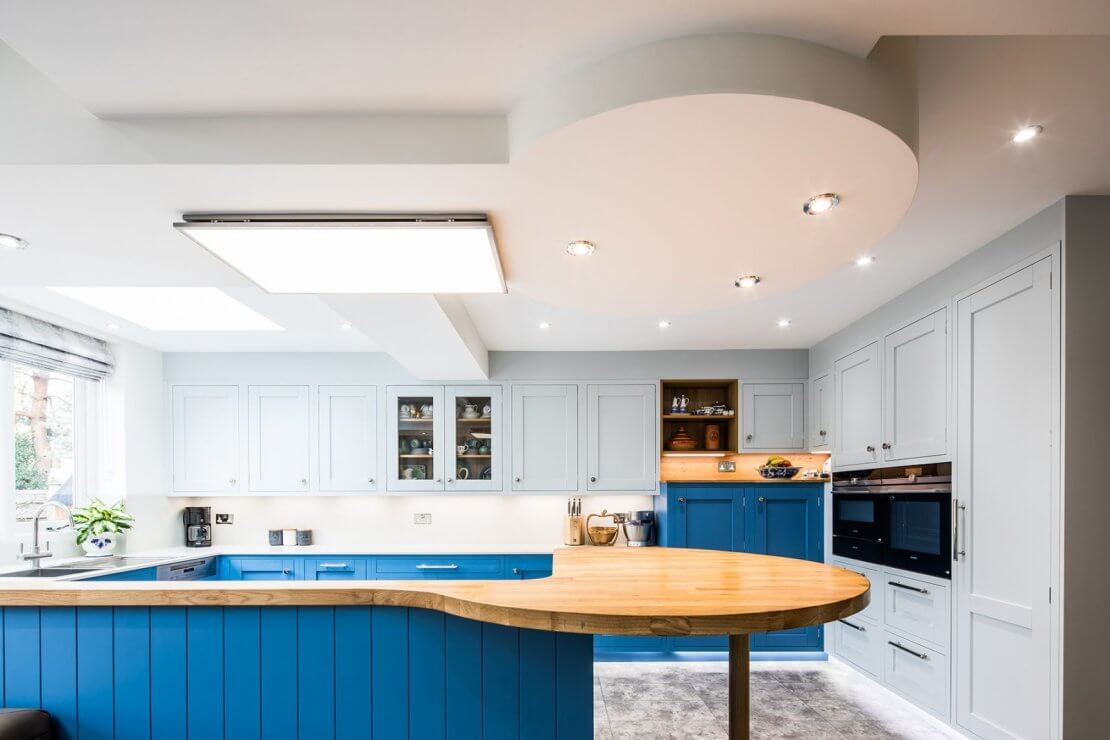 large blue kitchen with in frame doors