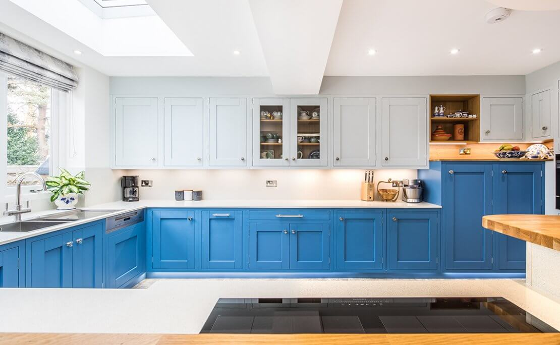 large blue kitchen with lighter coloured wall cabinets