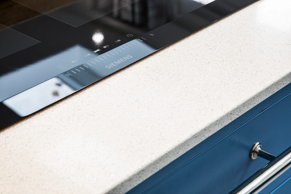 white recycled glass worktop with siemens induction hob