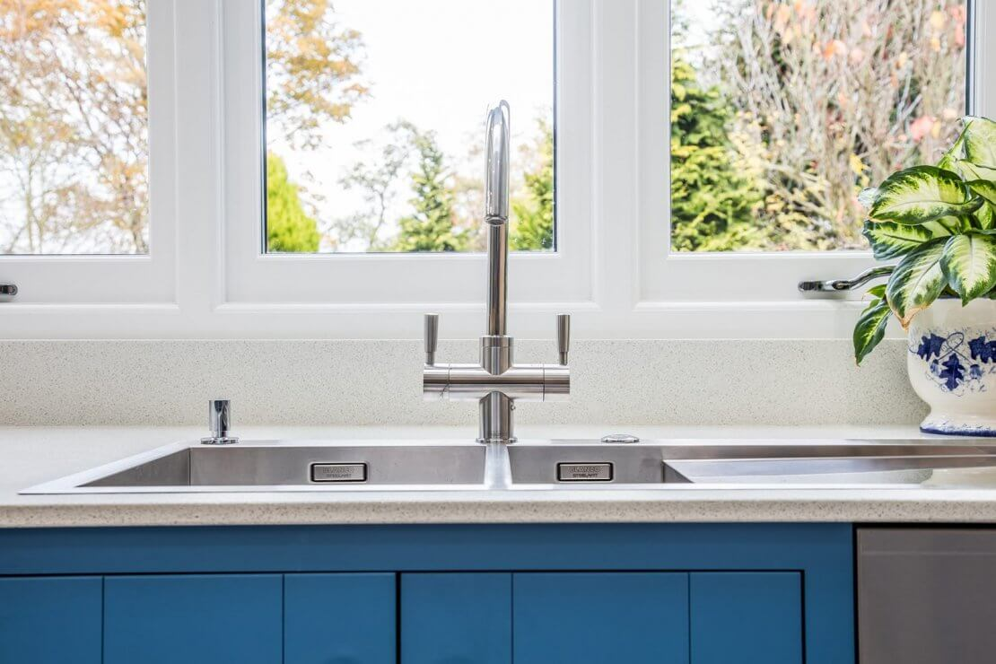 new sink and tap in blue kitchen