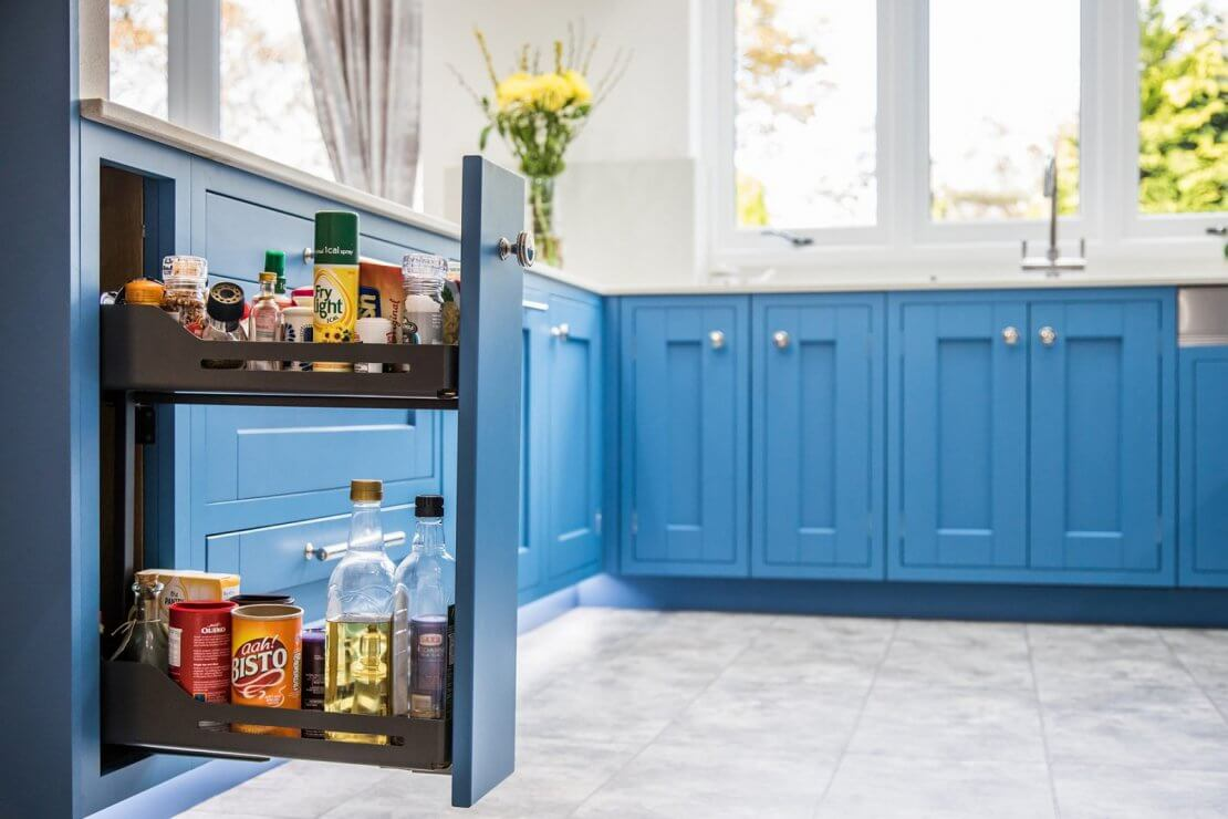 slimline pullout kitchen storage with oils and spices on