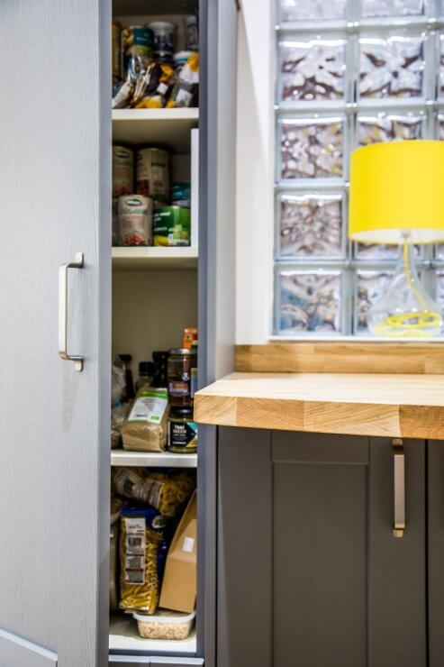 grey shaker painted u-shaped kitchen with timber breakfast bar