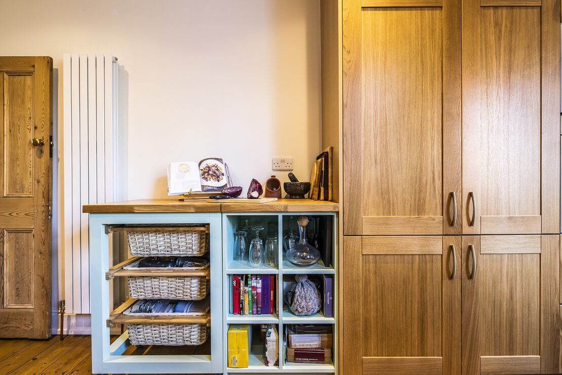 Sheffield Sustainable Kitchens oak and green compact kitchen with integrated fridge freezer