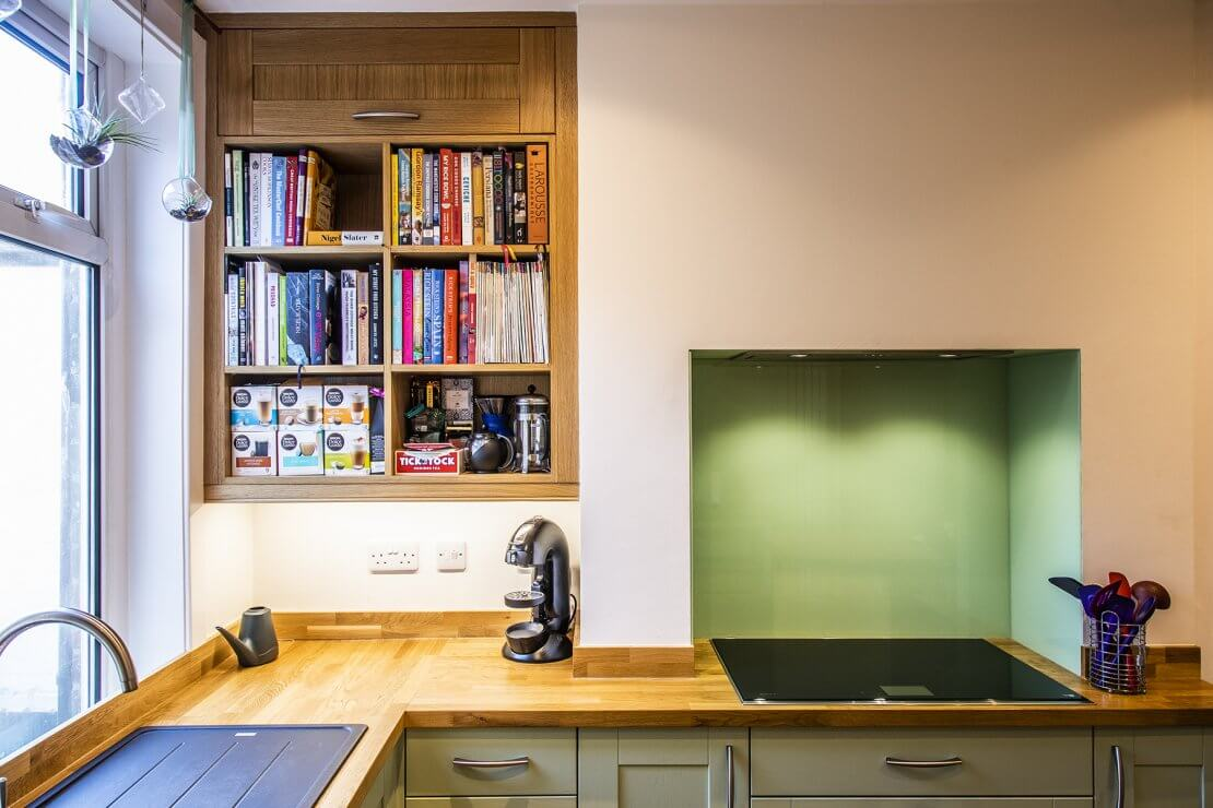Sheffield Sustainable Kitchens oak and green compact kitchen with bookshelves