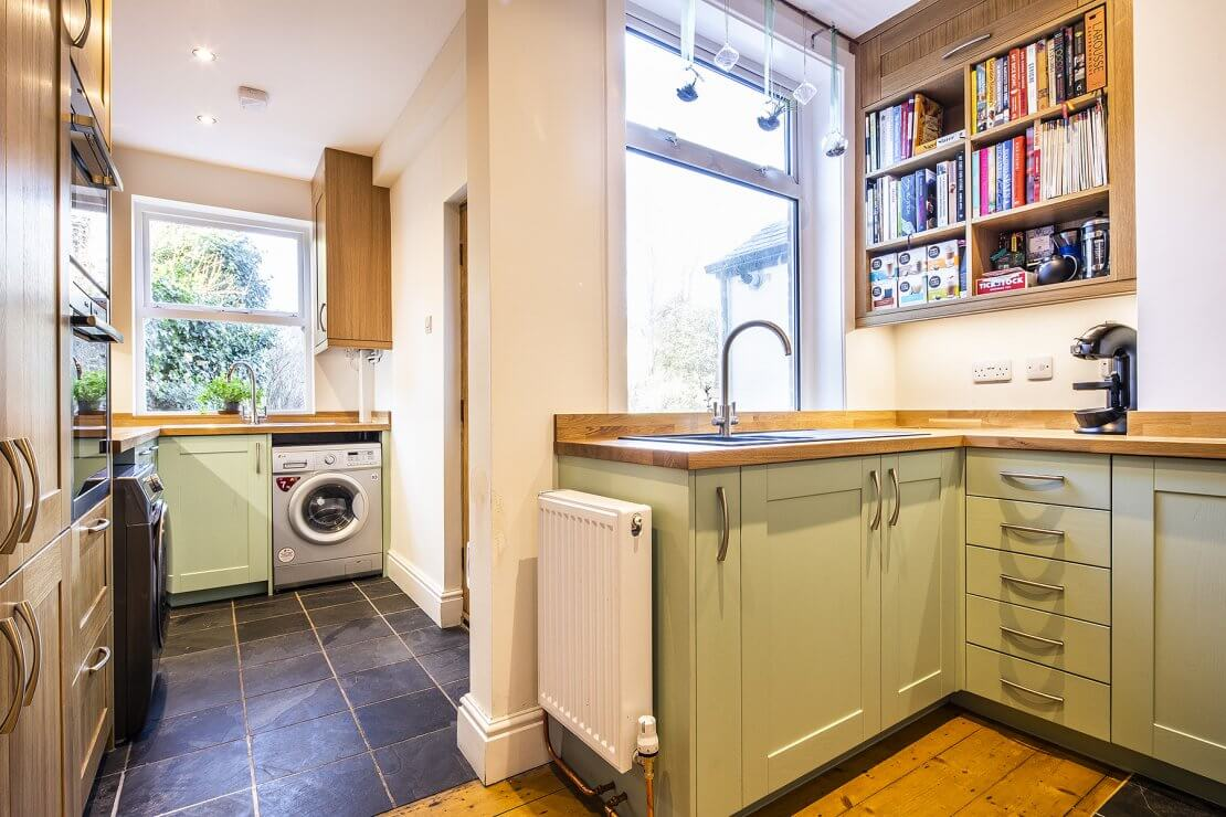 Sheffield Sustainable Kitchens oak and green compact kitchen with fragranite sink