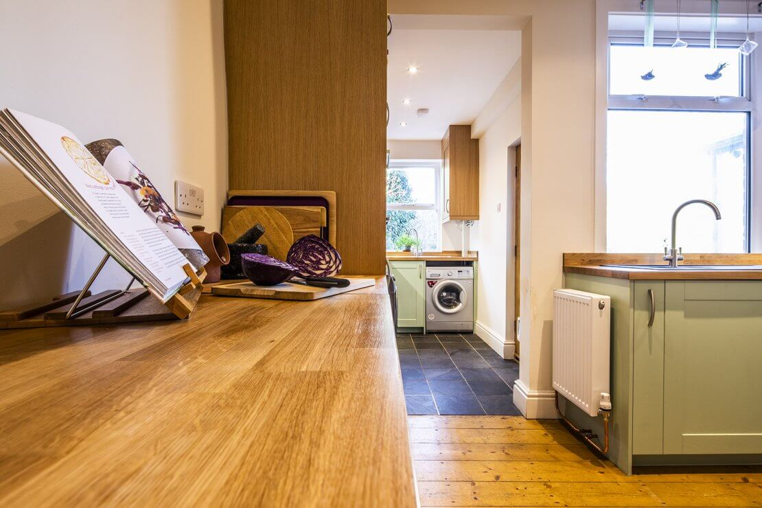 Sheffield Sustainable Kitchens oak and green compact kitchen with breakfast bar