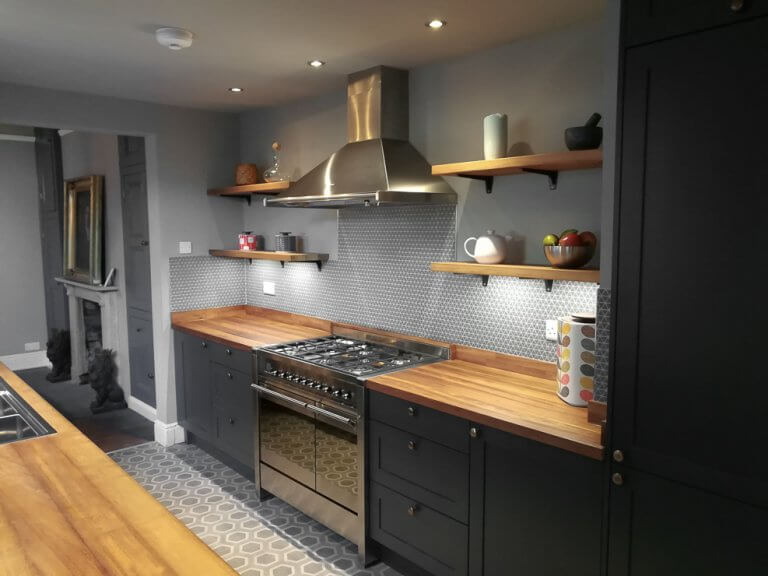 shaker galley kitchen in dark grey with timber worktops