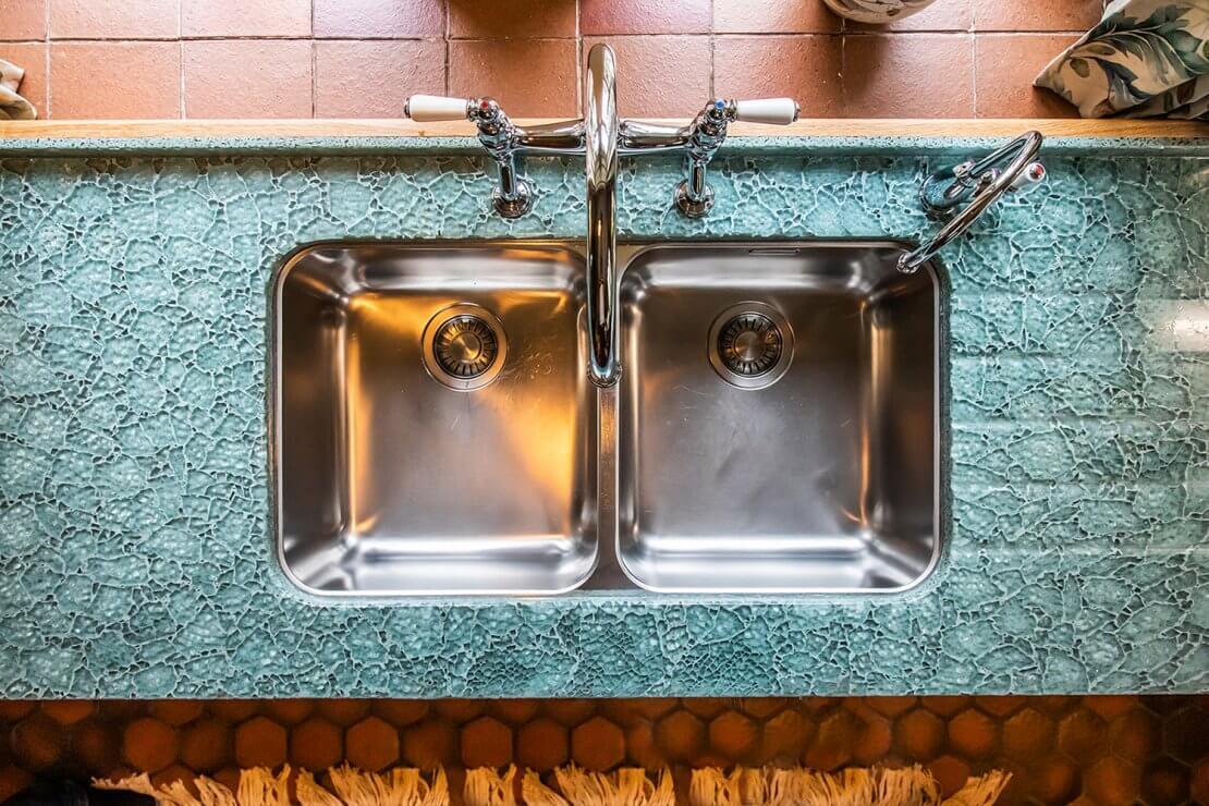 stainless sink and taps in bespoke new large u-shaped kitchen