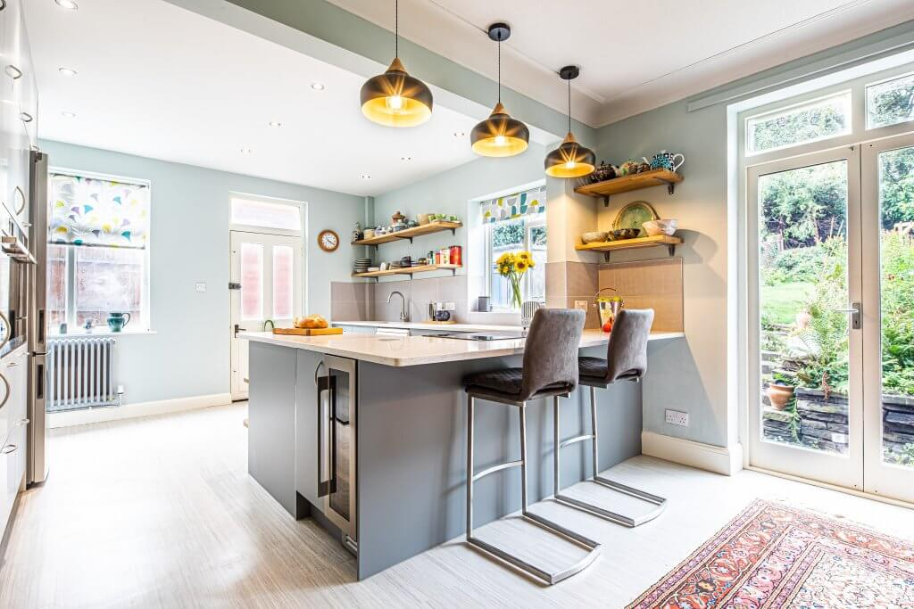 new sheffield sustainable kitchen with storage and quartz worktop and peninsula