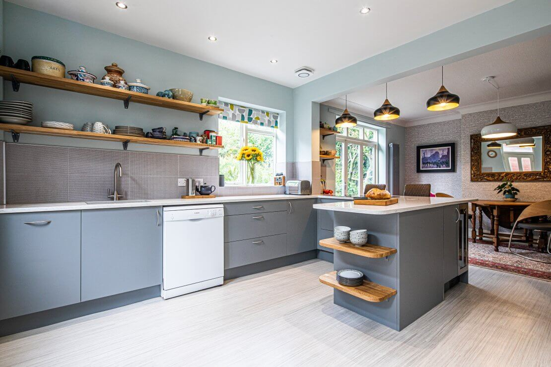 new sheffield sustainable kitchen with storage and quartz worktop and oak open shelving