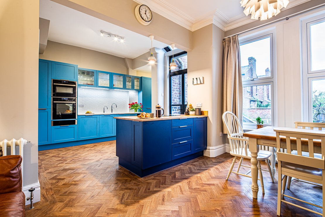 Blue kitchen in Manchester with oak and recycled glass worktops